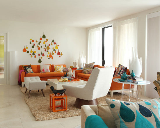 White Living Room With Two Orange Sofas And Matching Accessories