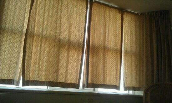 Four DIY curtain panels hung at a bright window