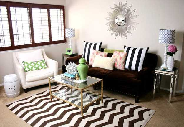 Zig Zag Black And White Rug With Matching Cushions On A Black Sofa
