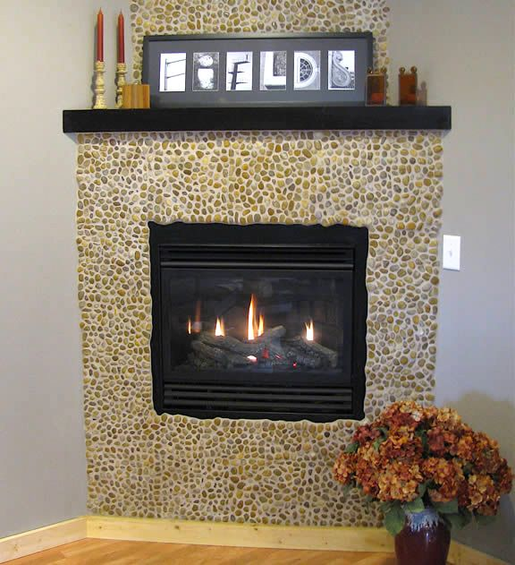 A small pebble dashed fire surround, around a black frame fire