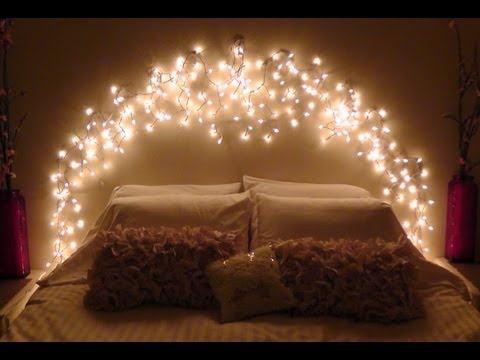 An arch of fairy lights hung over a double bed