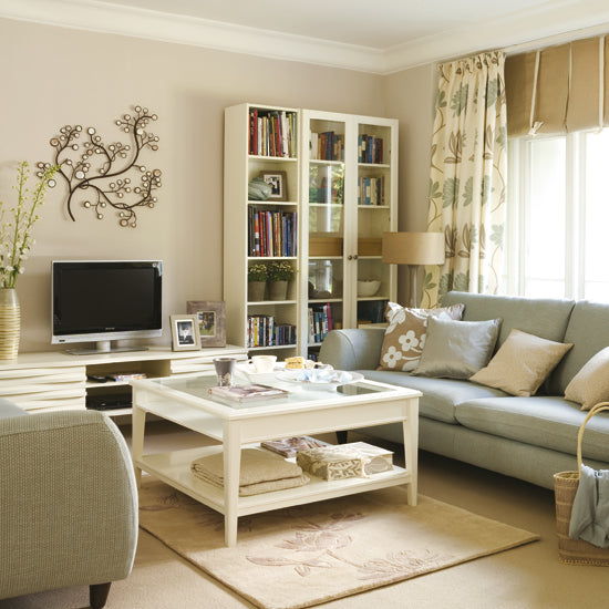 Classy living room with lots of cream, beige's and grey sofa