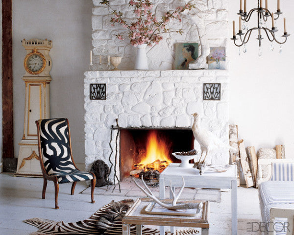 White living room with white stone clad fireplace