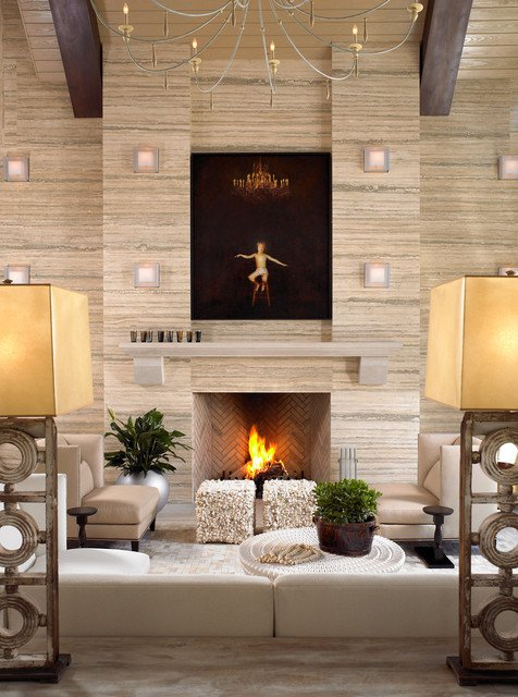 Cream and beige living space with cream sofas, with large fire surround with brown artistic canvas above the fire