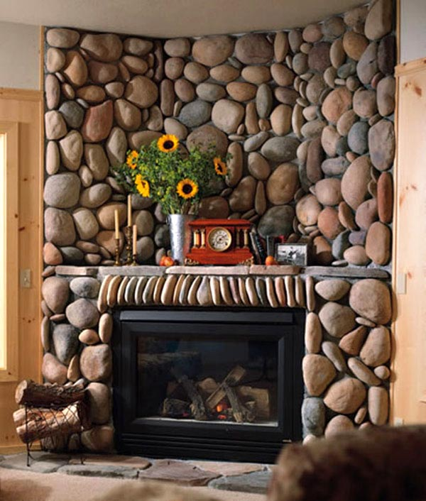 Natural stacked stones surrounding a black framed fire, in a living room