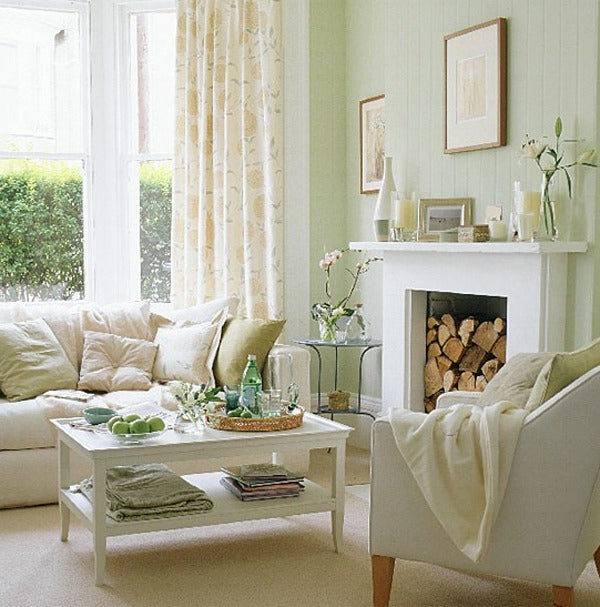 Cream and light green living room with white fireplace and white coffee table