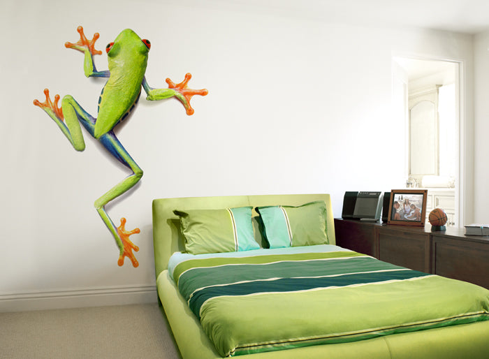 Green and orange frog decal in a bedroom