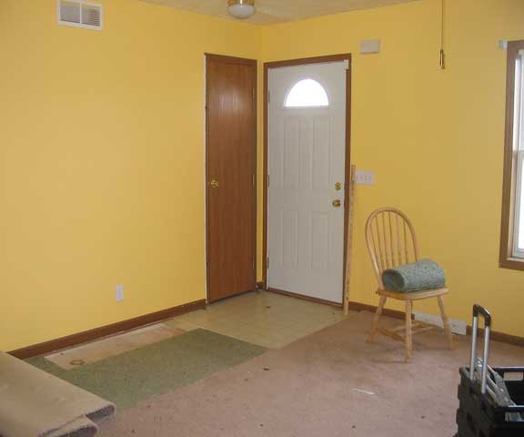Redecorating with yellow walls and the carpet pulled up
