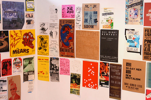 Walls covered in different coloured posters