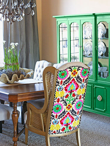 Green Plate Cabinet In Dining Room With Bright Upholstered Dining Chair At An Oak Table