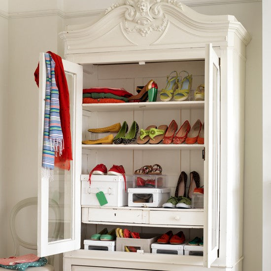 White closet with glass front for storing womans shoes