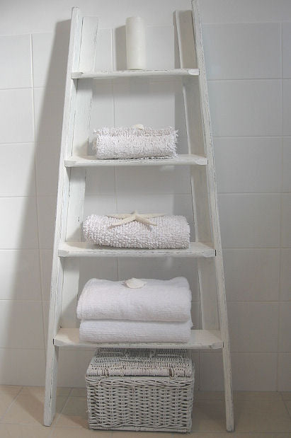 White Ladders In The Bathroom Used As Shelves For Towels