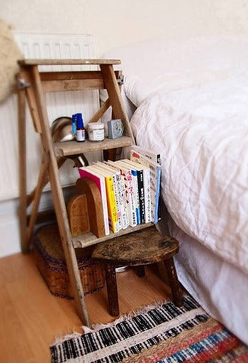 Rustic Wooden Step Ladder Used As A Bedside Table