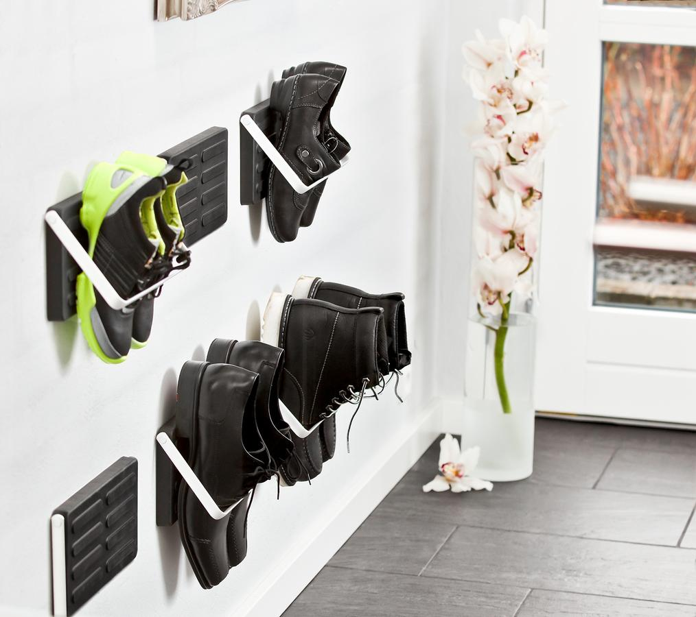 Wall mounted shoe storage by the front door, like a mouse trap but for shoes