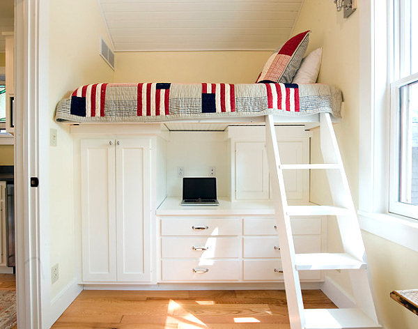 Loft bed in a guest room with a desk