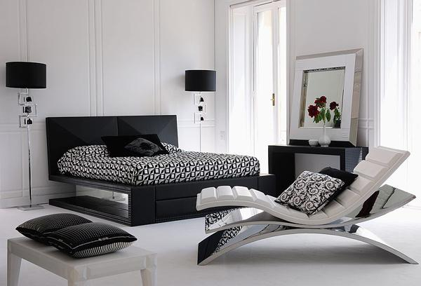 Black and white bedroom, with funky and modern chair lounger at the end of the bed