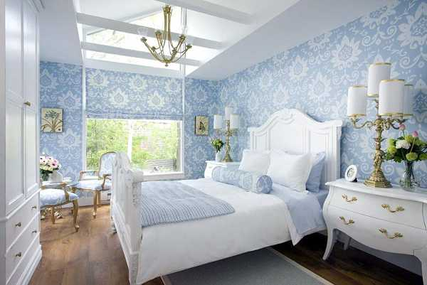 Light blue and white bedroom with traditional white wooden bed frame