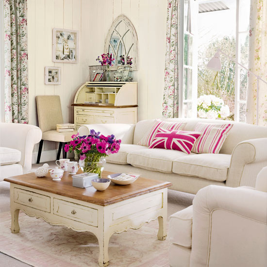 Cream Sofa, Floral Curtains In The Background And Touched Of Pink