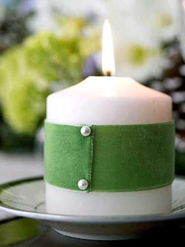 White candle wrapped in green fabric