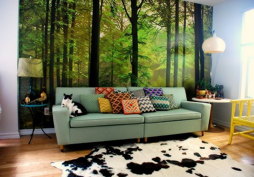 Wall painting living room with cat on the sofa