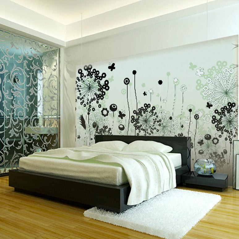 Light wooden floor and large glass headboard with intricate dandelion floral design