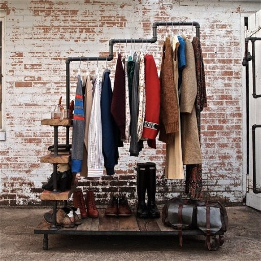 Staggered industrial pipe clothes rail with three tiers