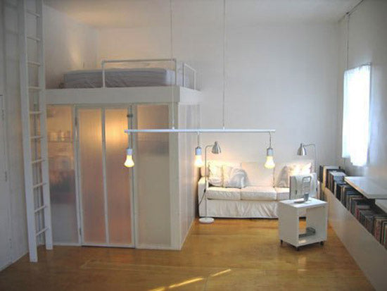 Loft bed with underneath storage in a white room