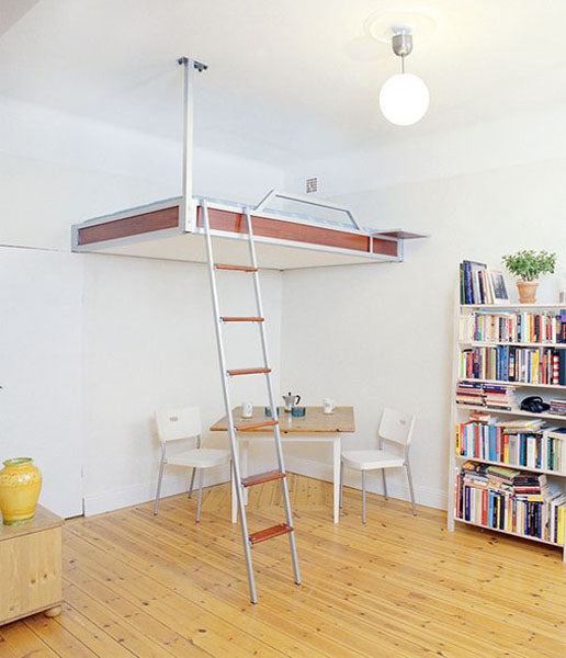 Suspended loft bed with dining table underneath it