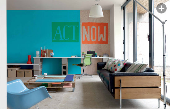 Two tone living room with wall quote