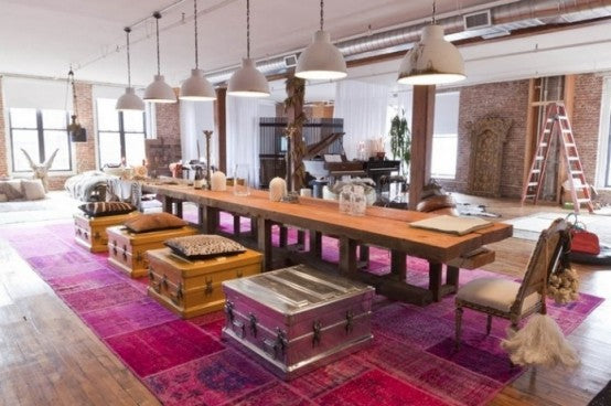 Large Open Plan Dining Room With Large Long Wooden Table On A Massive Pink Rug