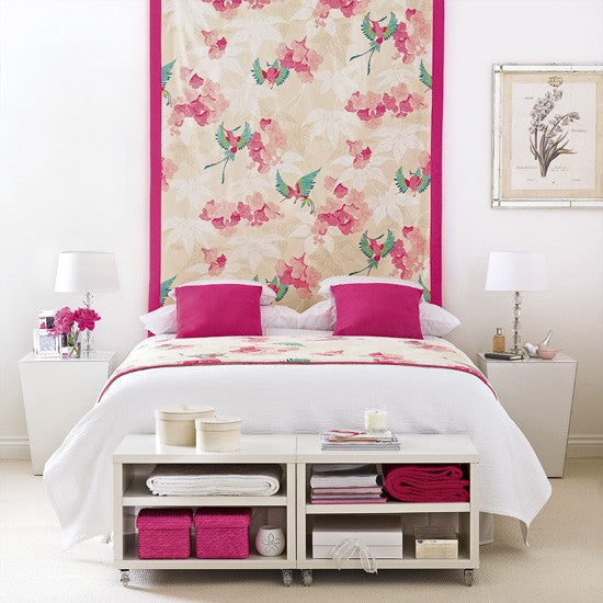 White and pink bedroom with beige and pink floral canvas above the bed