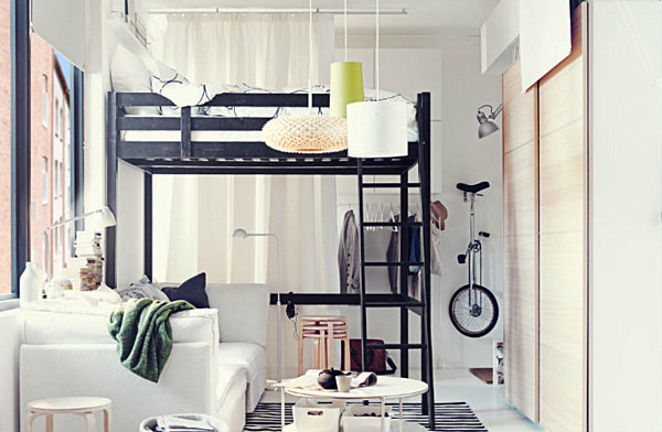 Queen size white loft bed frame in a white and cream room