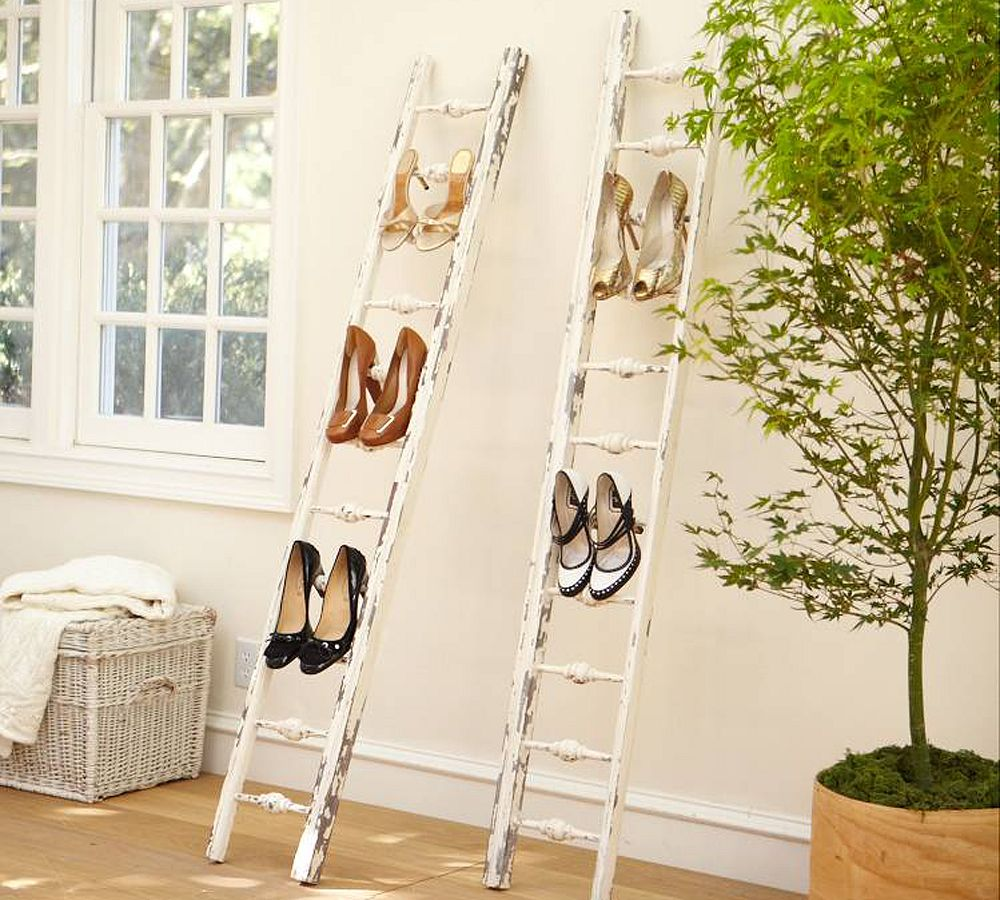 Two upcycled white ladders used as shoe racks