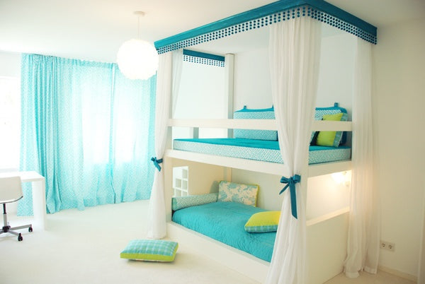 White and teal bunk bed in a white room
