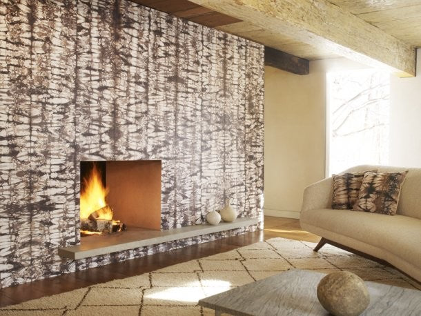A natural white and brown tie dye effect on fireplace wallpaper