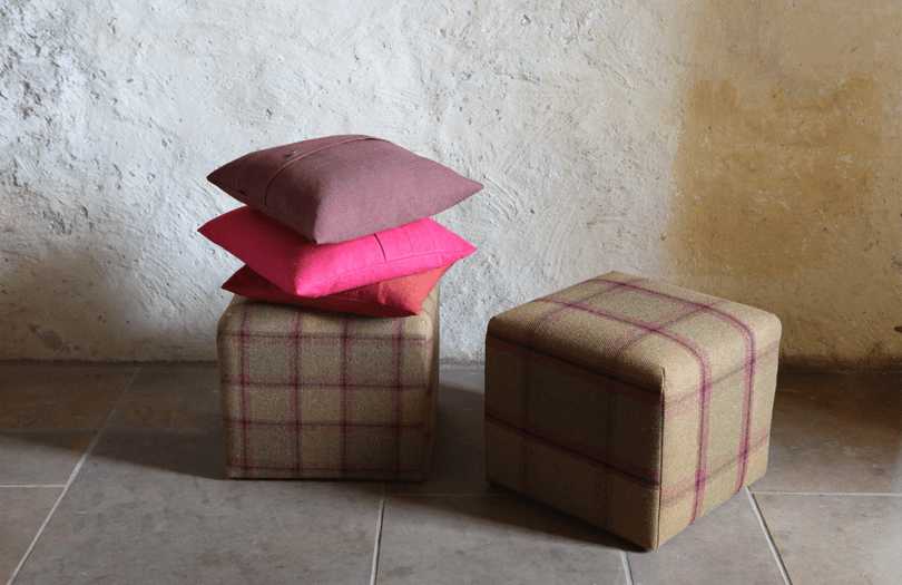 Beige and red tartan footstools, with red cushions on top