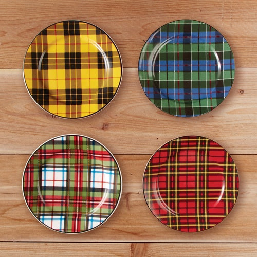 Four plates mounted on a wall with different coloured tartan designs