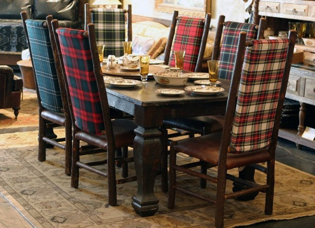 Wooden dining table with wooden chairs, upholstered with tartan fabric