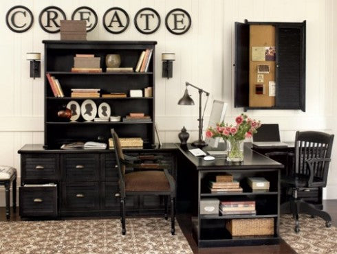 Black and white home office, with black shelves, storage and desk