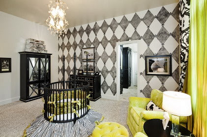 Black and white modern kids nursery, with touches of green too