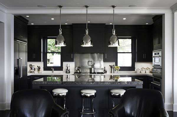 Black and white kitchen with stainless steel finishes and accessories