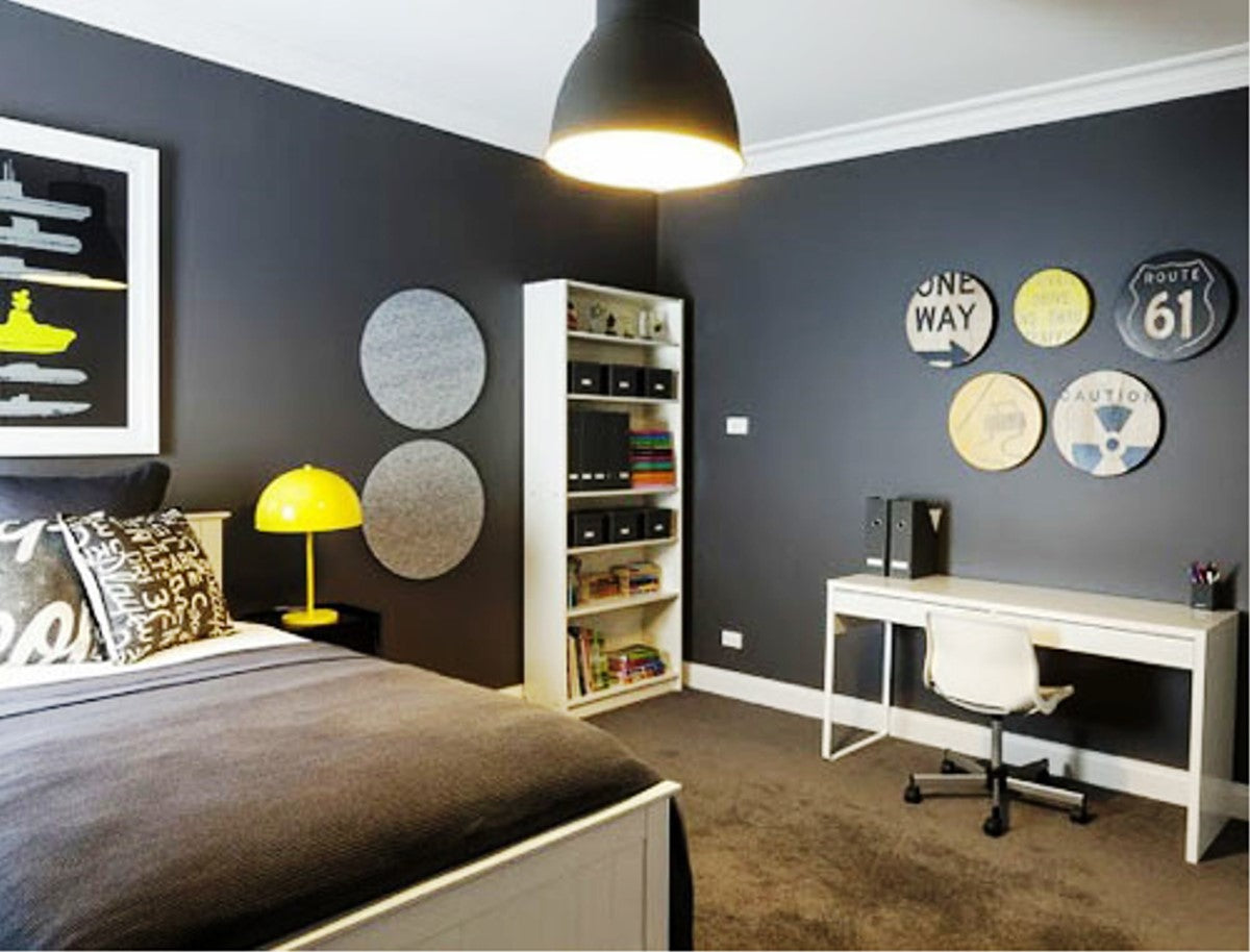 Black, White And Yellow Boys Bedroom With Funky Clocks On The Wall
