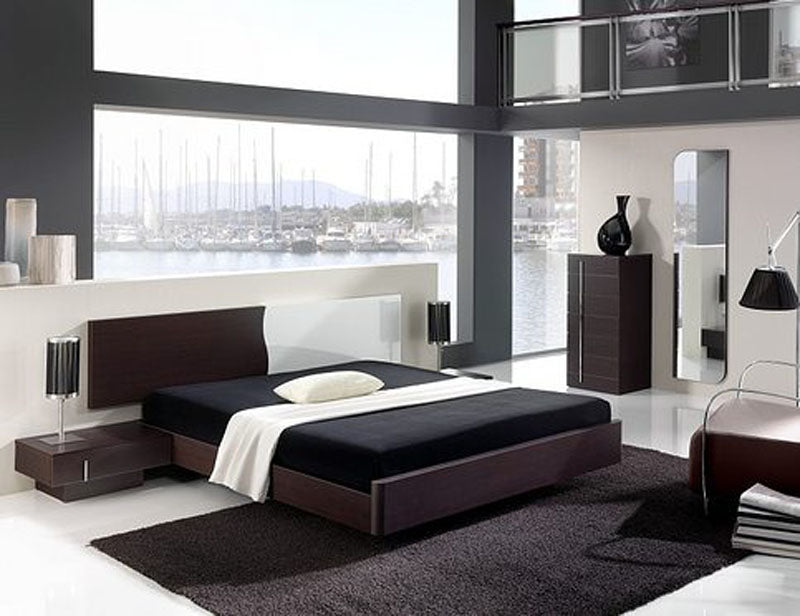 Very Classy Bedroom With Large Windows Overlooking A Marina