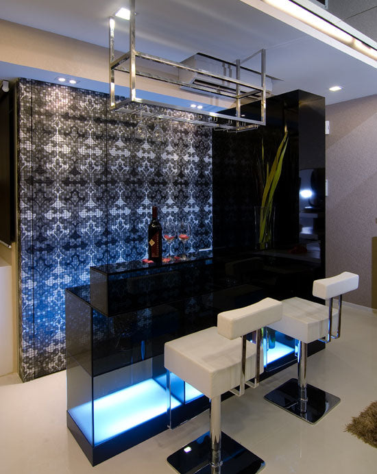 Modern home bar made from black glass with white swivel bar chairs