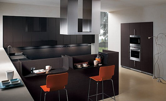 Modern black and white kitchen with breakfast bar and orange bar stools