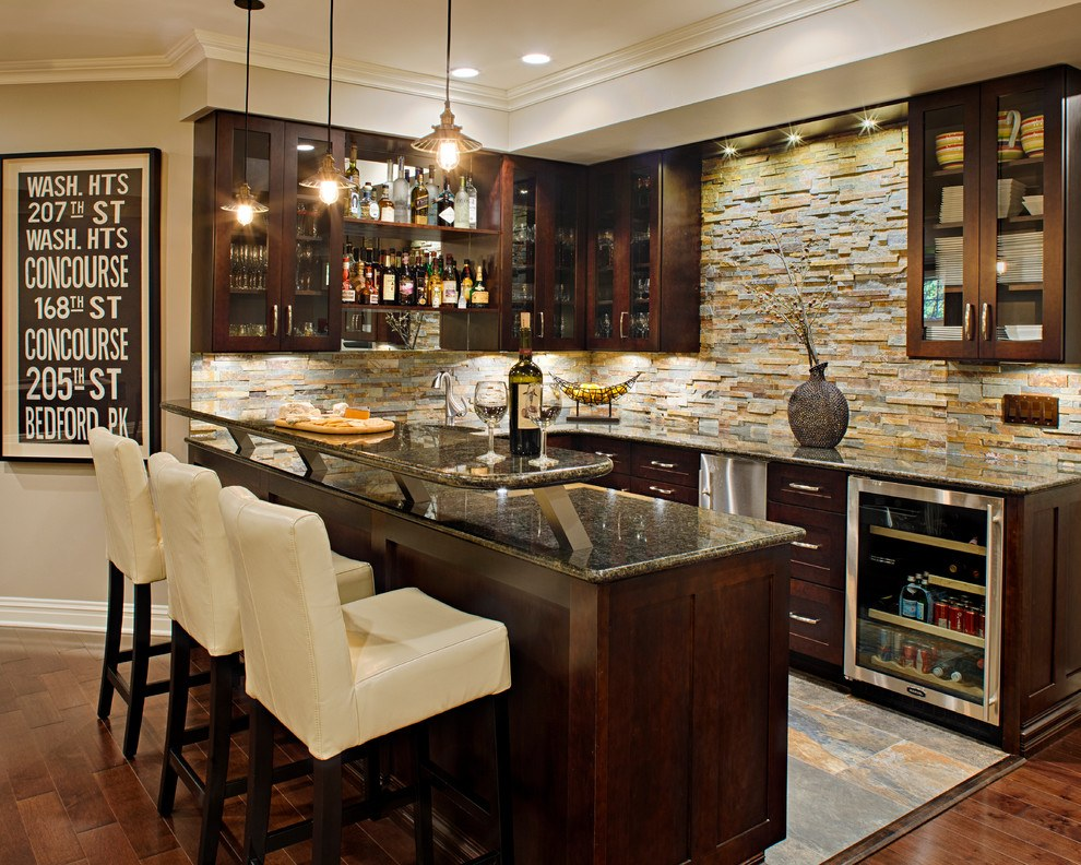 Sublime home bar with dark stained units and grey marble counter tops