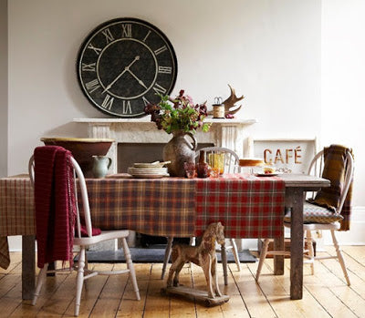 Wooden dining table with tartan tablecloth