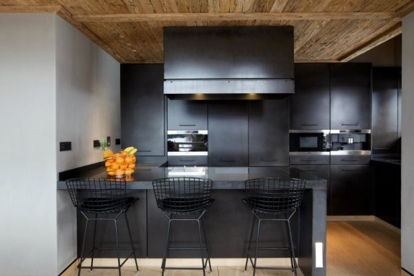 Black kitchen with breakfast bar and black bar stools