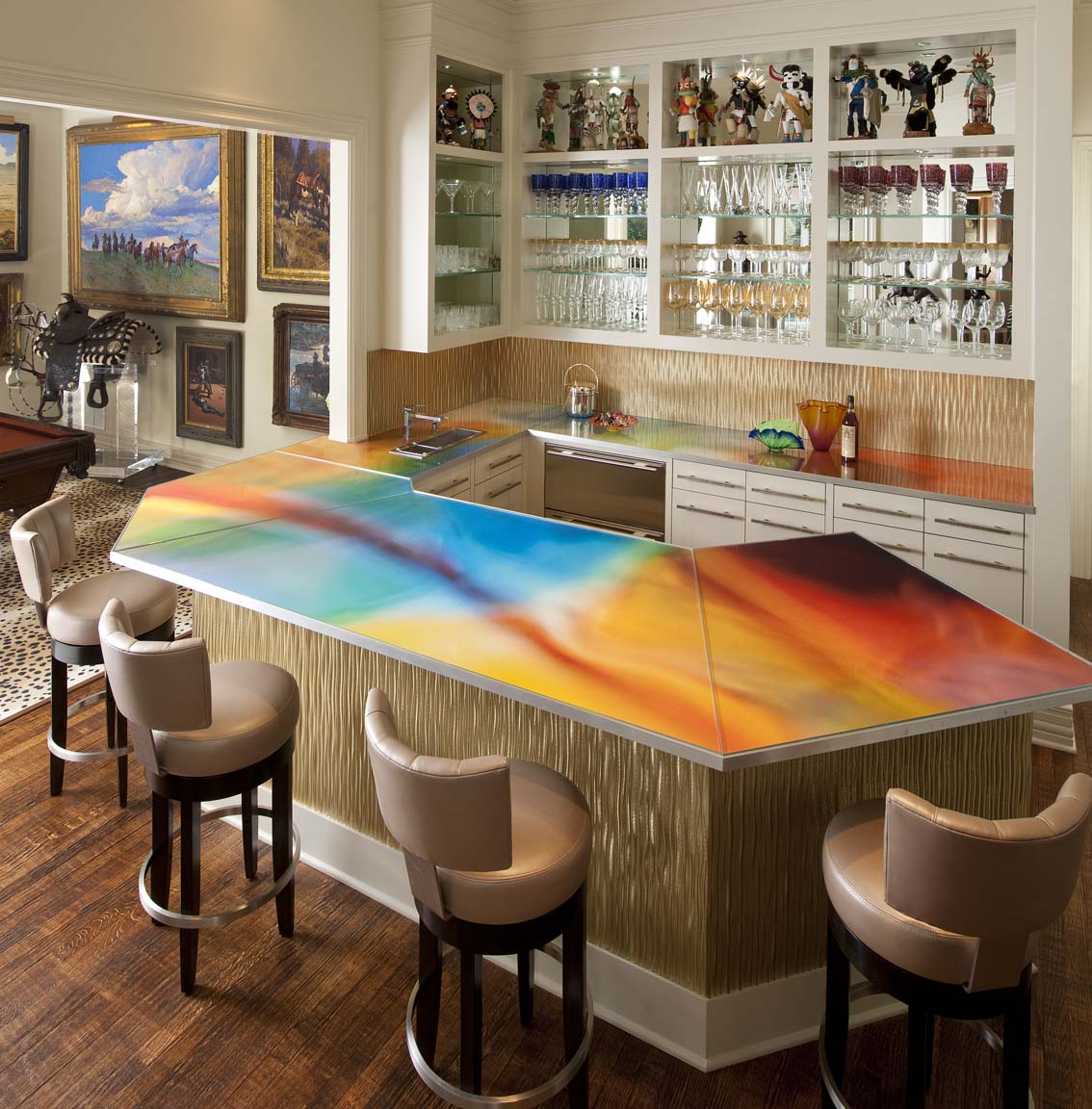 Funky home bar with counter top that has a swirling mixture of bright colours