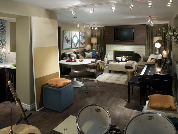Basement music room with piano, guitar, drums and relaxing sofa space